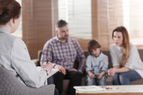 A social worker speaks with a family