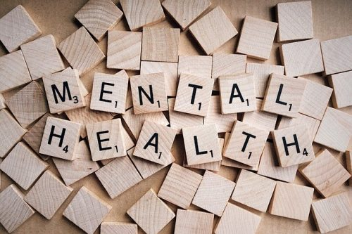 The words mental health spelled out with wooden blocks