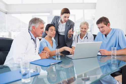 Nurses and a doctor meet with health administrator