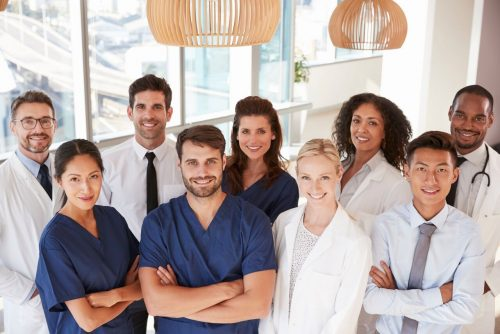 A group of smiling health care professionals.