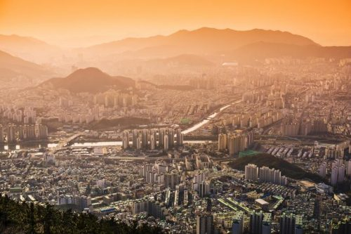 City blanketed in an orange haze of air pollution