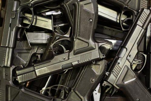 Large pile of handguns.