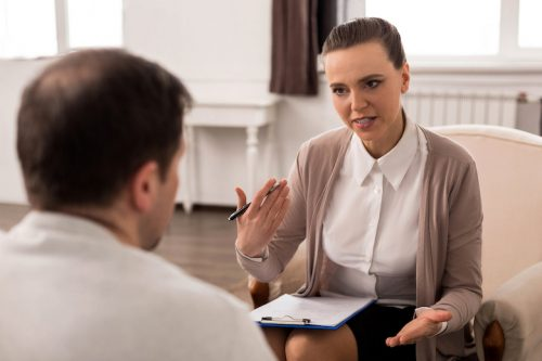 clinical social worker speaks with a client
