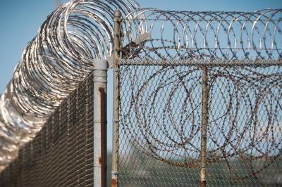 barbed wire around prison fence