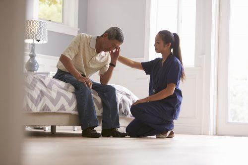 Psychiatric nurse makes home visit to a depressed patient.