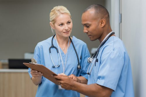 Registered nurses check patients' charting records.