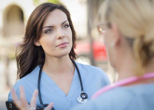 Nurse listening to advice from supervisor