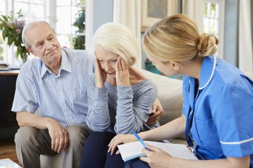 Nurse treating dementia patient and spouse