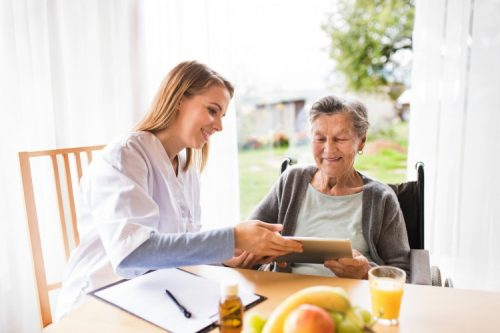 Health care worker explaining health literacy to elderly patient