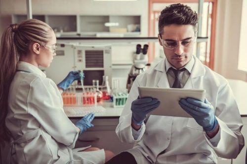 Health care researchers working in lab.