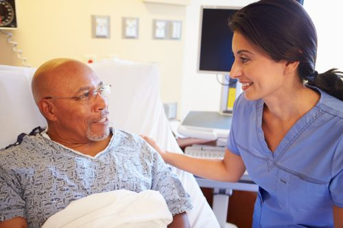 : Friendly-conversation-about-care-between-nurse-and-patient-builds-trust-and-is-an-example-of-patient-advocacy-in-nursing.
