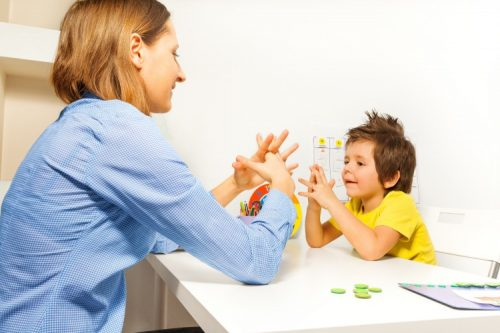 ABA therapist works with a child diagnosed with autism
