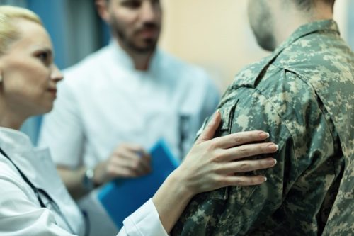 A veteran discusses his health with physicians.