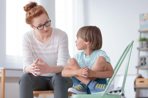 ABA therapist works with a child who has been disruptive.