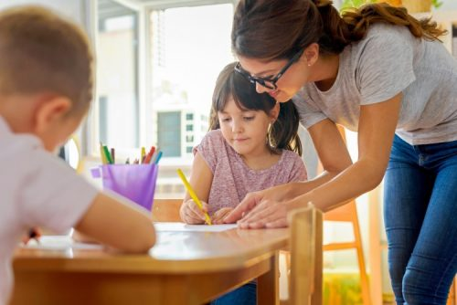 A teacher uses positive behavior support in the classroom.