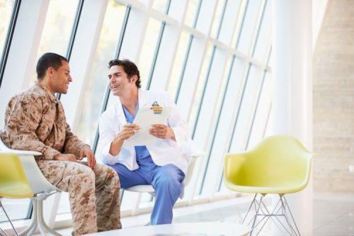 A nurse counsels a patient.