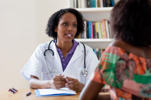 A nurse consults with a mental health patient.
