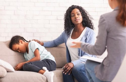 A mother and daughter meet with a psychiatric mental health nurse practitioner.