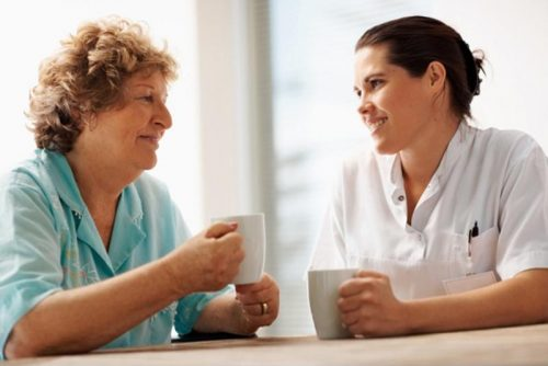Two healthcare professionals having a conversation