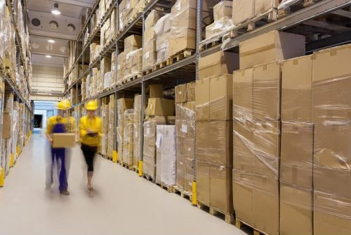 Workers-tour-the-stock-room-of-a-warehouse