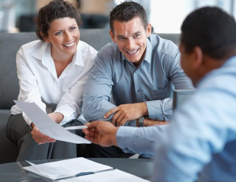 A financial advisor shares documents with clients