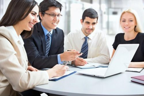 Group of tax experts working on a computer