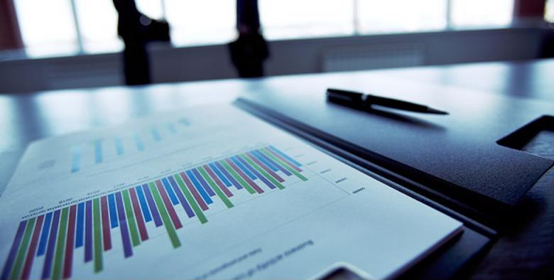 Financial reports on a boardroom table