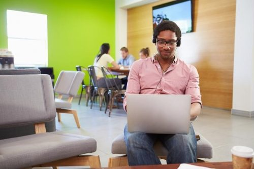 A working professional attends an online MST class by logging on through his laptop.