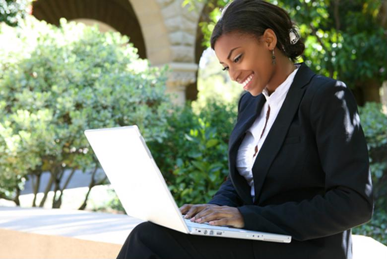 A financial professional studies online