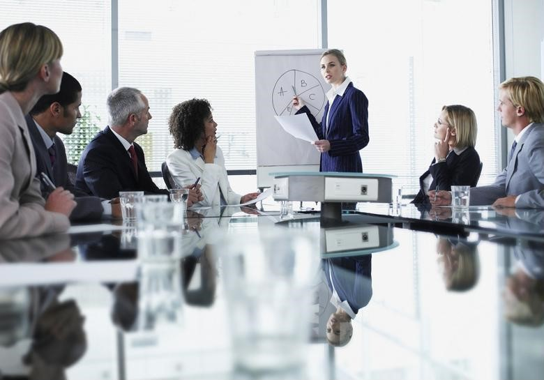 A CFO delivers a presentation to other executives