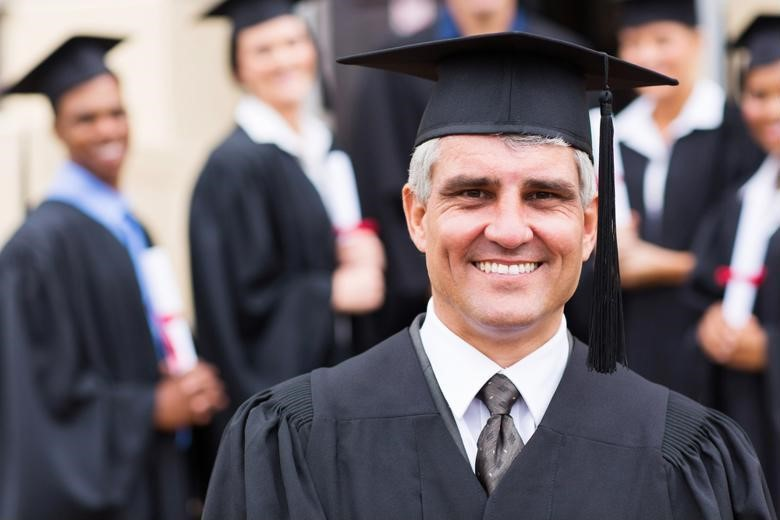 Graduate student receiving his master's in finance degree.