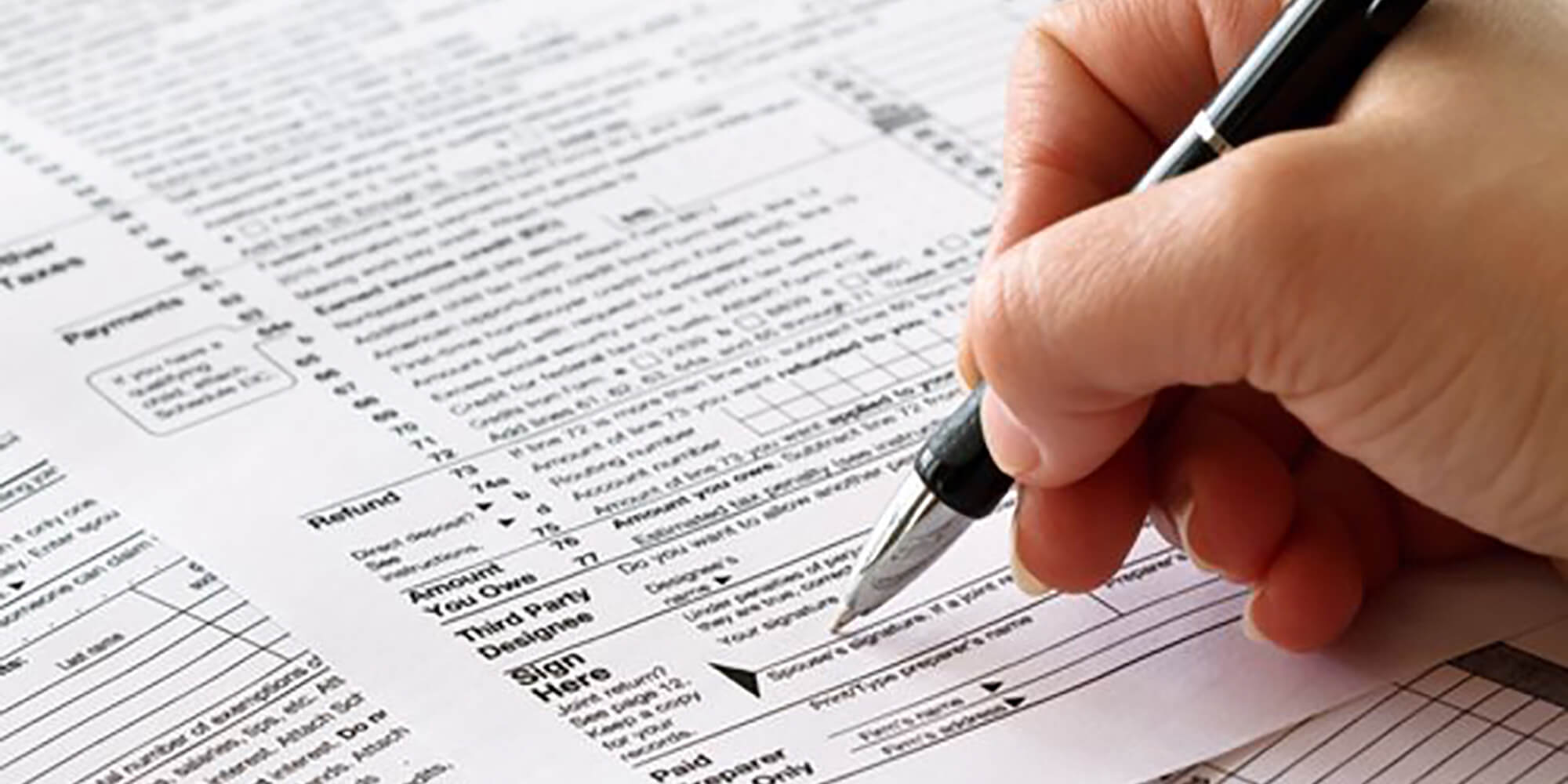 Person filling out an IRS tax form