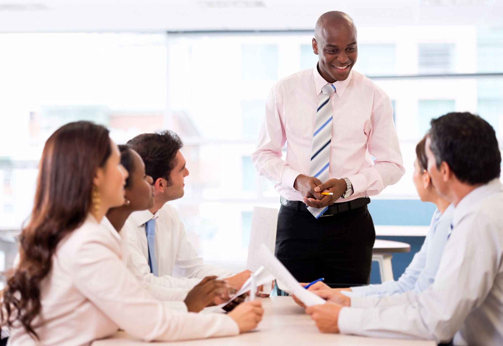 Man leading team meeting