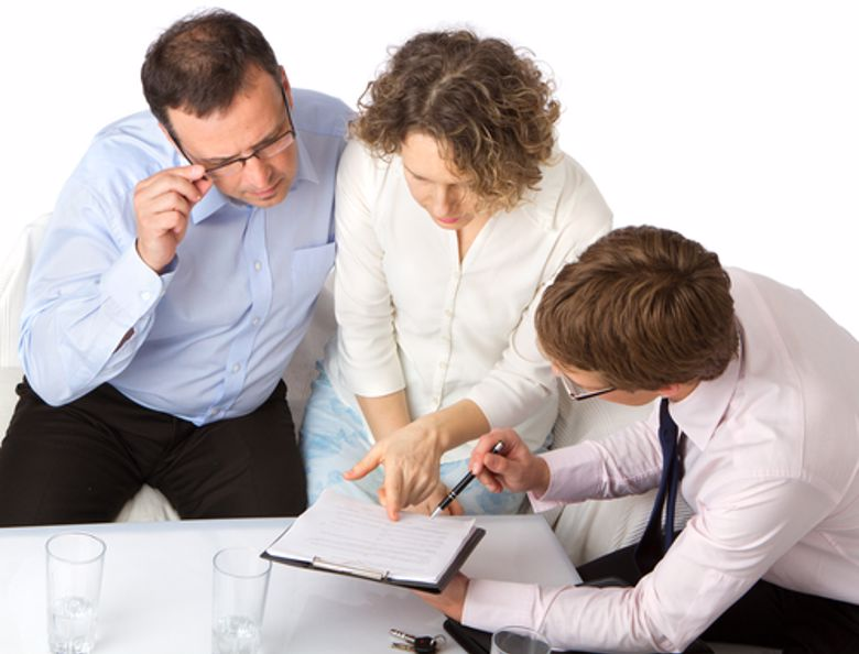 A tax accountant shows a financial document.