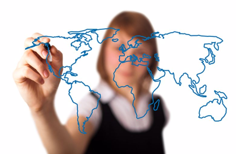 A businesswoman draws a map of the world.