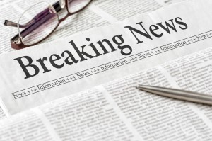 Newspaper with breaking news heading