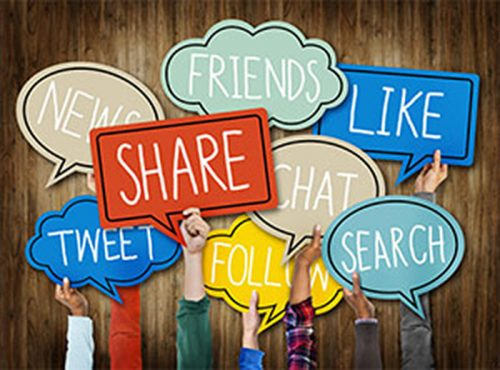 Hands holding up signs with social media terms: friends, news, tweet, follow, like, share, chat and search.