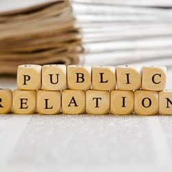 Letter blocks spelling Public Relations