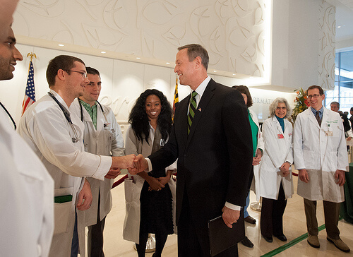 Hospital CEO shaking hands with doctors and medical staff