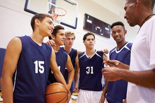 High school basketball team with coach