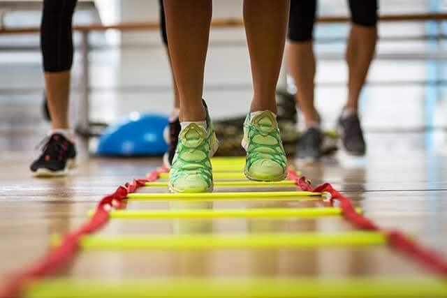 Athletes training with workouts on a gym floor
