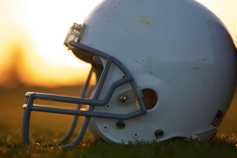 White football helmet on the field