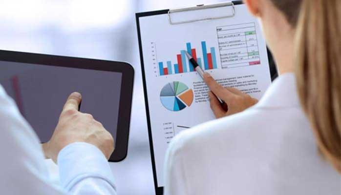 Professional and woman looking at financial charts