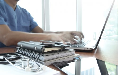 Nurse working on laptop