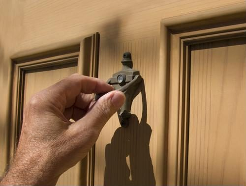 Hand on door knocker