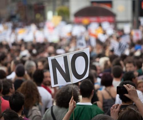 """""""No"""" sign among group of protesters"""