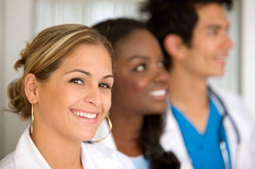 Three nurses smiling
