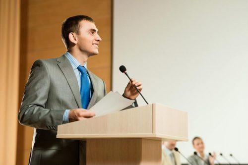 A political candidate giving a speech.