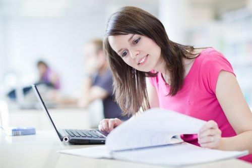 An online student studies on her laptop.