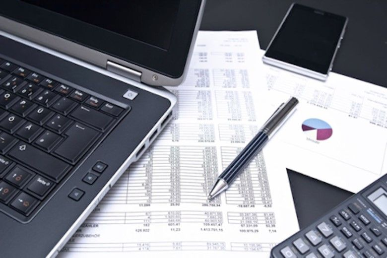 financial tools and documents laid out on a table